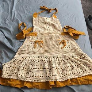 Anthropologie mustard crochet apron